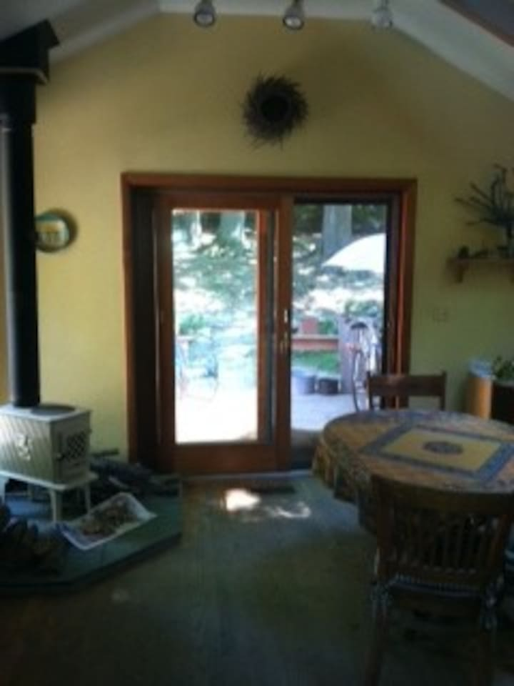 Dining room with skylights, wood stove and deck.