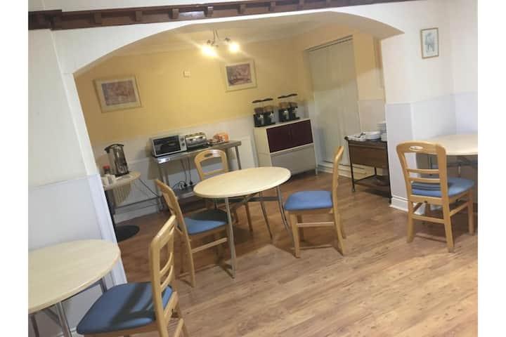 Standard Triple Room in OYO The Longlands Hotel