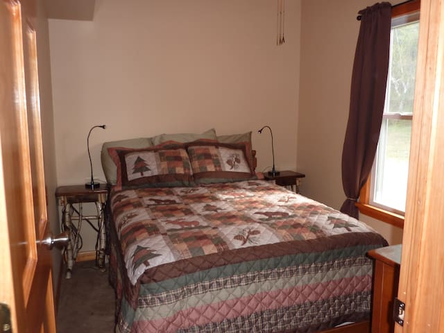 Private bedroom with a full bed on ground floor.
