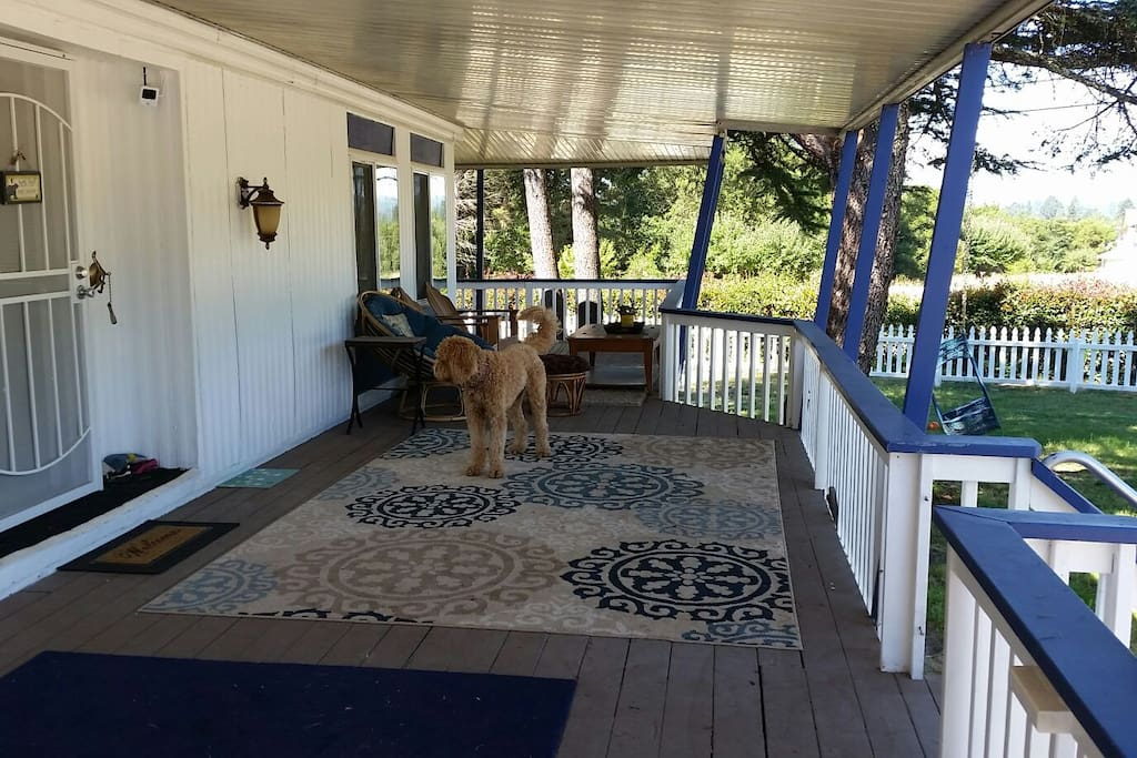 Wrap around porch to relax on.