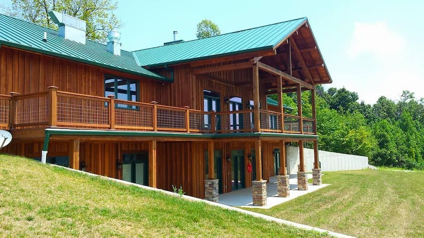 This is the back of the lodge with two tiers to relax and enjoy the view.