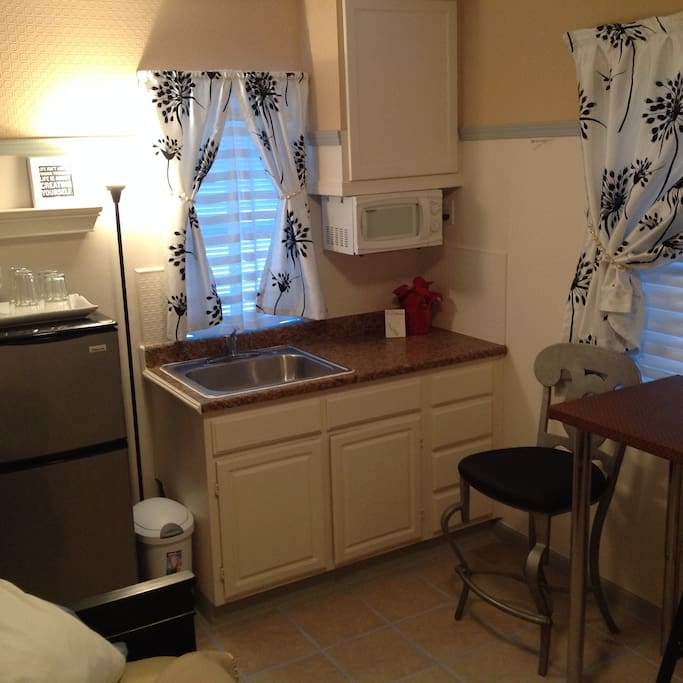 Breakfast kitchen with microwave, refrigerator, coffee maker.