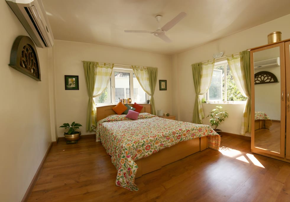 Spacious double room with AC, wardrobe, tea and coffee making facilities.