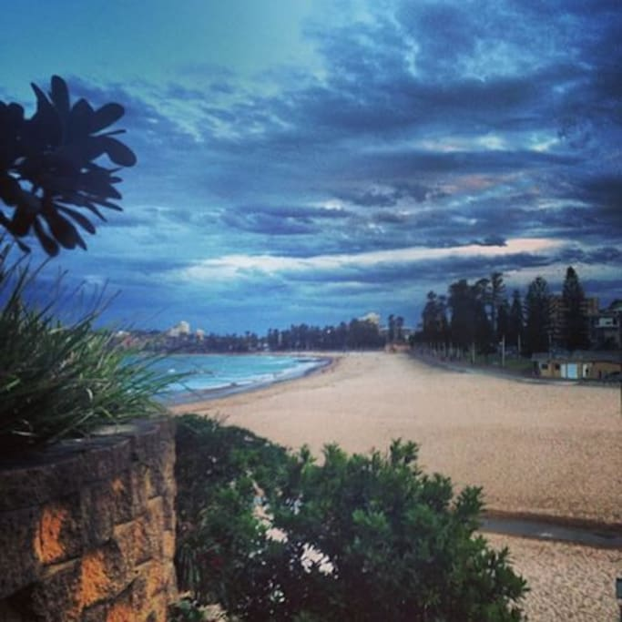 Outside the apartment entrance, just walk down the stairs to step onto Manly Beach