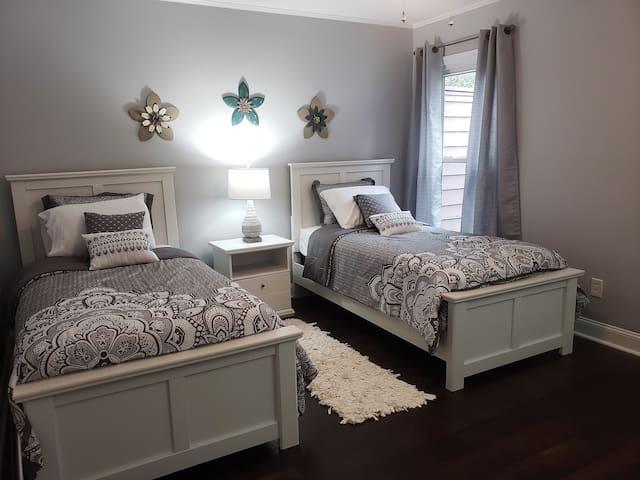 Main floor back bedroom with 2 twin beds