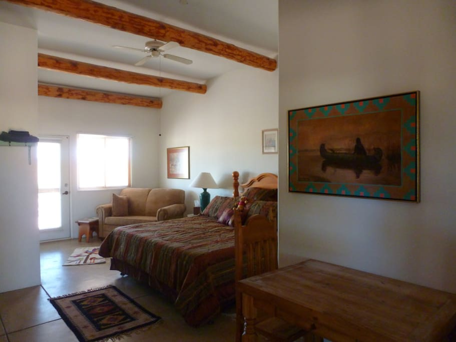 Mustang room with king bed, separate full bath, and eating area with refrigerator, microwave and coffee pot.