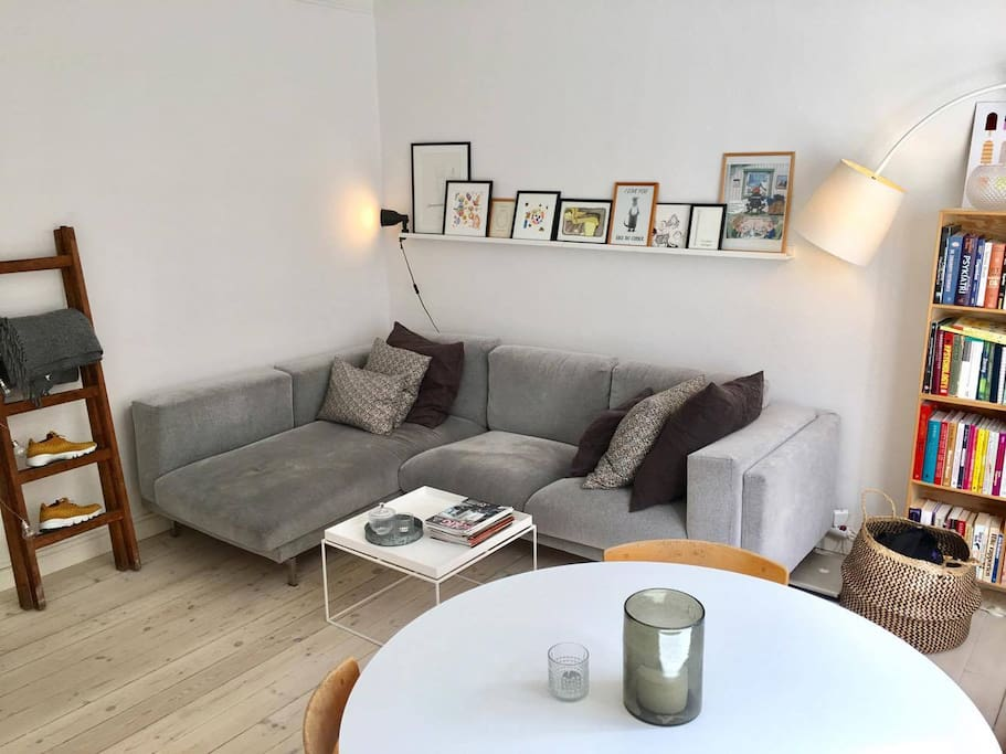 We love our big couch. Room enough for anyone! The art on the wall is carefully picked by Line