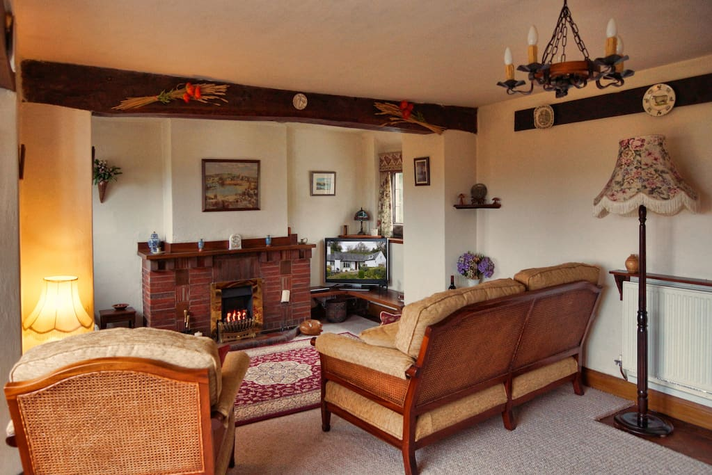 Spacious lounge with beams and inglenook Seats at least 6 people.