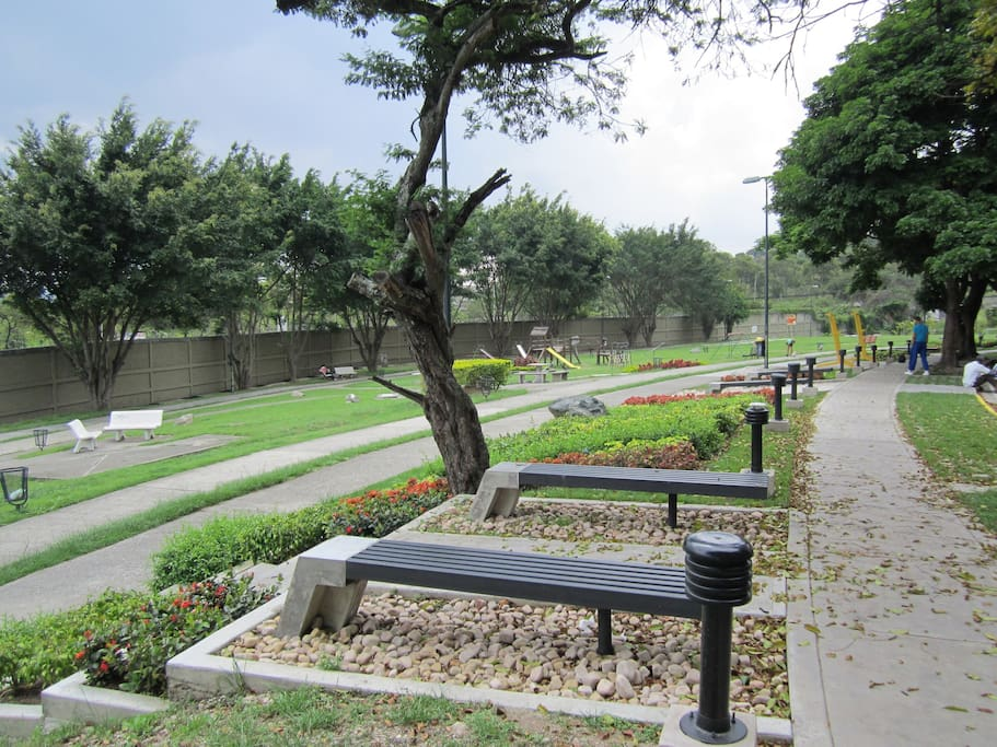Walking and exercise area, green areas; in from of the building
