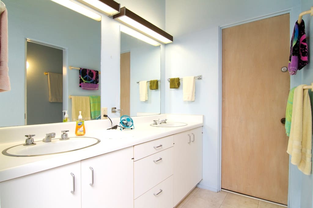 Bathroom, with double sink, that is down the hallway, but exclusively dedicated for interior room.
