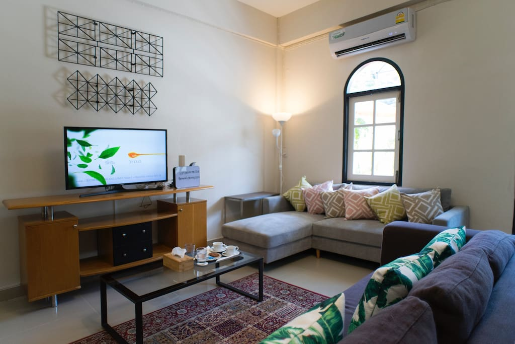 Living room : big sofa set with TV, apple TV box set in air-conditioning room