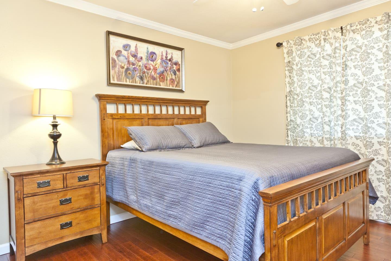 Second bedroom.  Queen beds and wood floors in all three bedrooms.