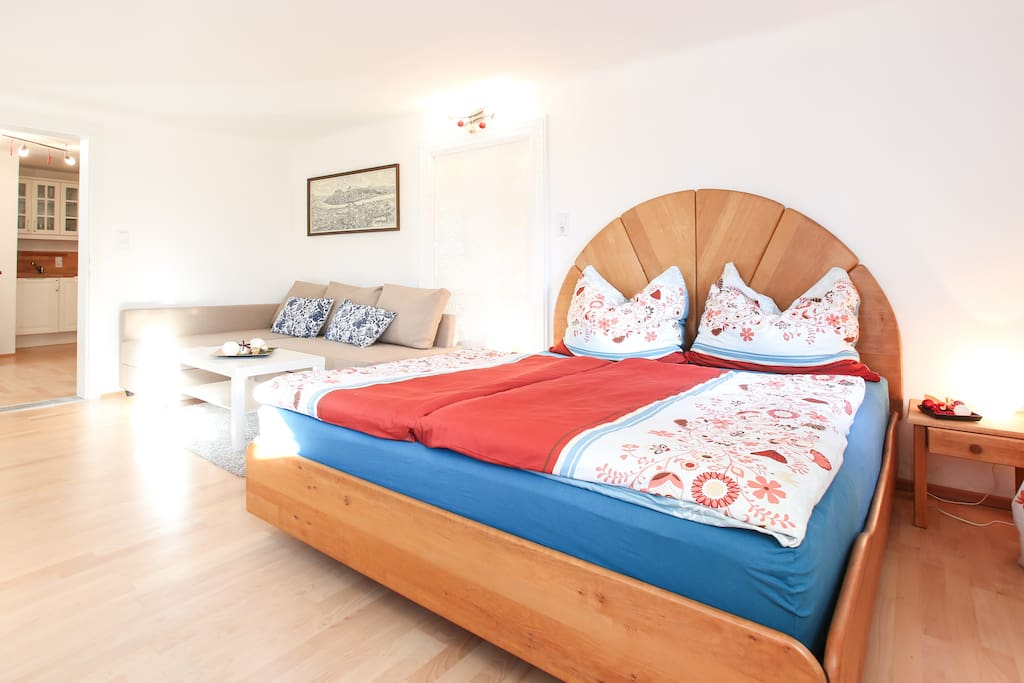 The massive wooden bed has an extra comfortable matress - perfect for a relaxing sleep!