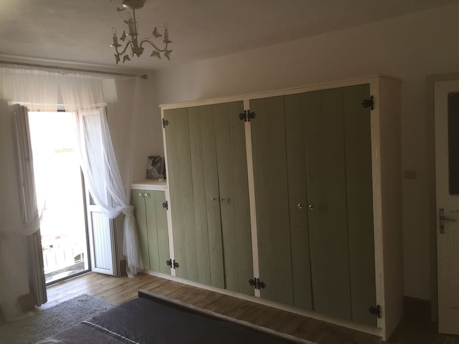 Master bedroom storage and French doors to balcony