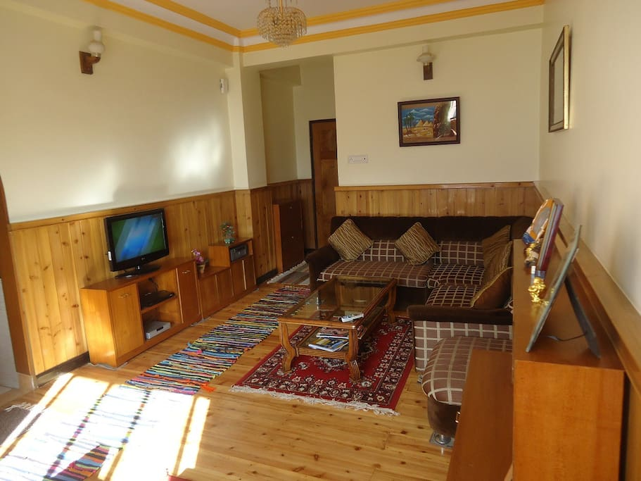 Living room with wooden flooring & wall  panels