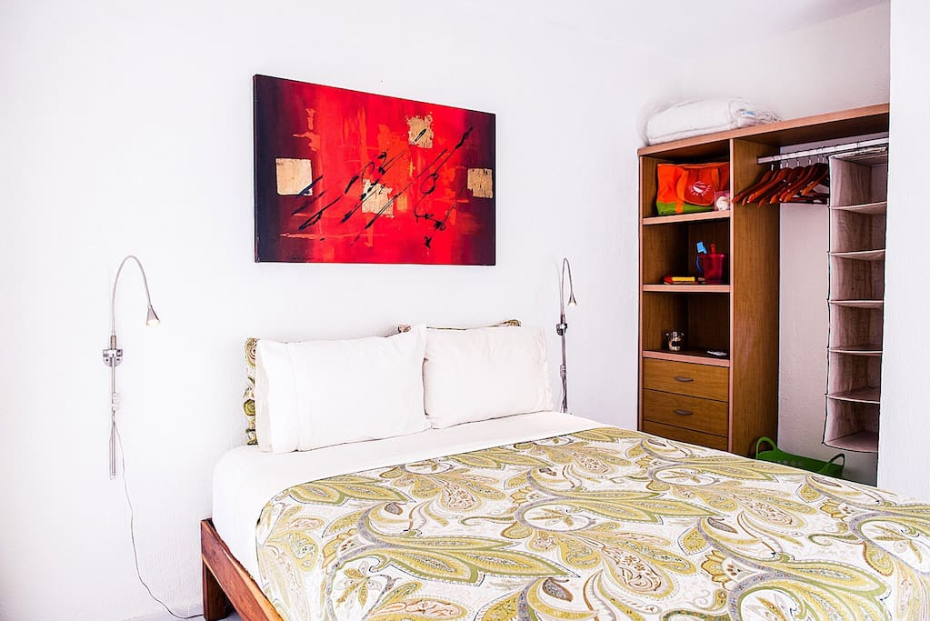 Your bedroom features a premium-quality queen-sized mattress and a mini-split air conditioner for a comfortable sleep.