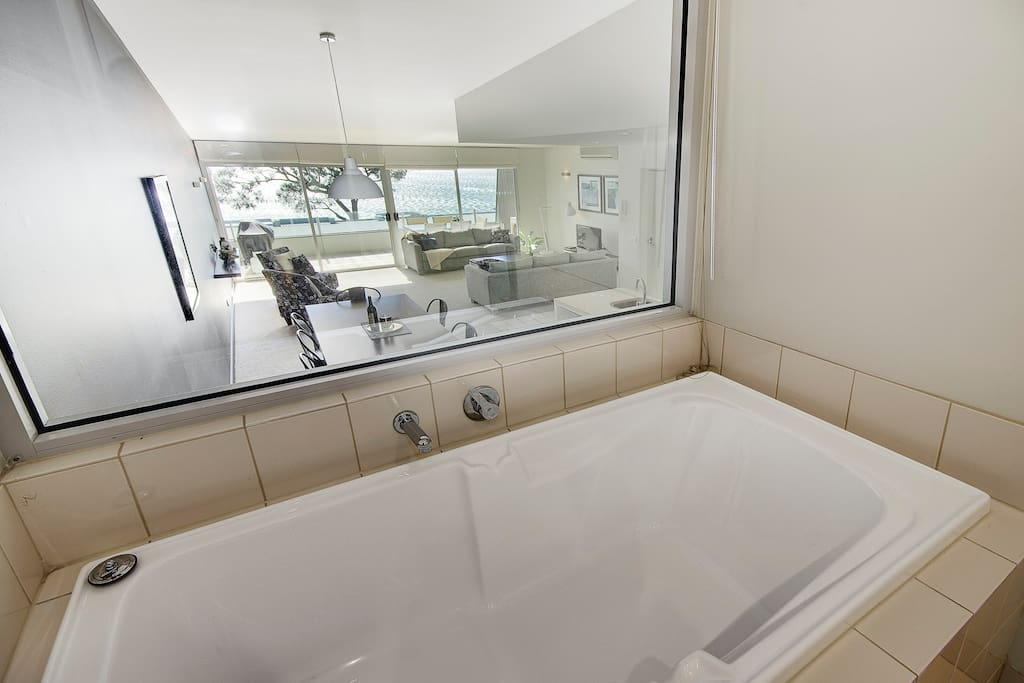 "I said ""wonderful"" ensuite - well check out the view from your bathtub!! The ensuite has  the bath, a handbasin, toilet and walk in shower. Of course the blind can be pulled to maintain your privacy - or opened to look across the lounge and south to the Ocean."