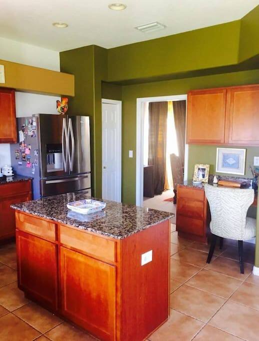 Modern appliances and your own shelve spaces, this bright kitchen also has a desk and a view of backyard, the spacious space has an island for meal preparation,  here is where my son love for cooking and entertaining started, it has uninviting design and open feel...enjoy