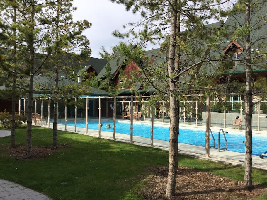 Inviting courtyard with Canmore's largest heated year round pool
