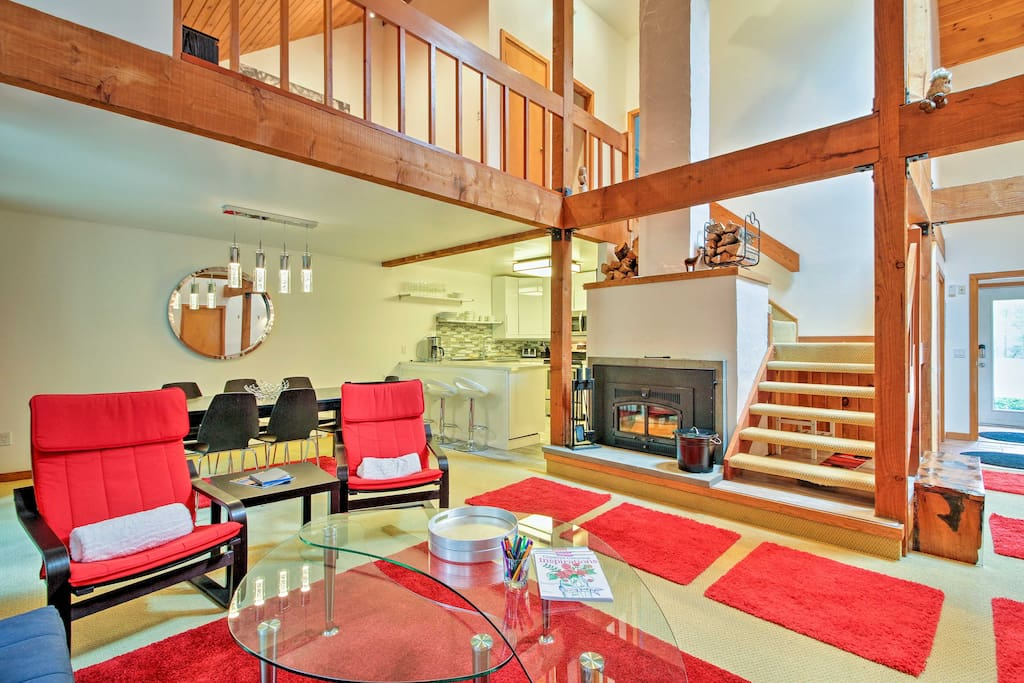 The 1,400-square-foot interior offers 12 lucky guests everything they need ranging from a wood-burning stove to a back deck.