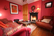 Cosy tv room with satellite sky  tv and DVD player, open easy to use gas  fireplace and lots of character features