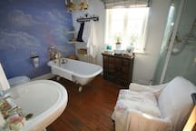 Large sunny bathroom with seperate shower room