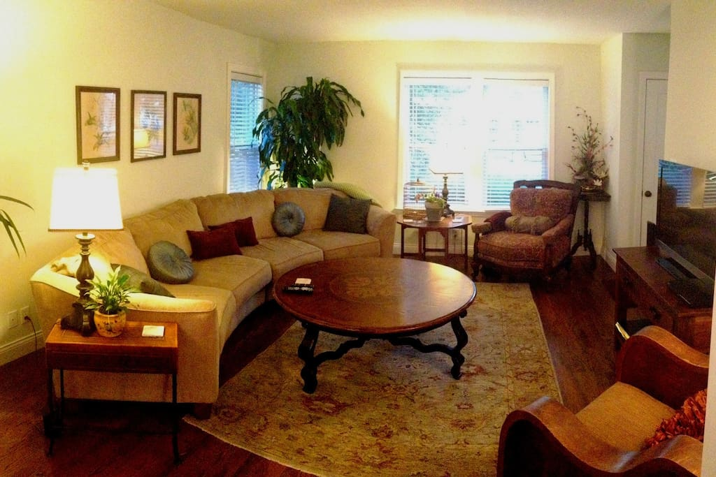 Main living room- large comfy, curved sofa and seating for relaxing or entertaining. ATTuverse, Netflix, and Bluray.