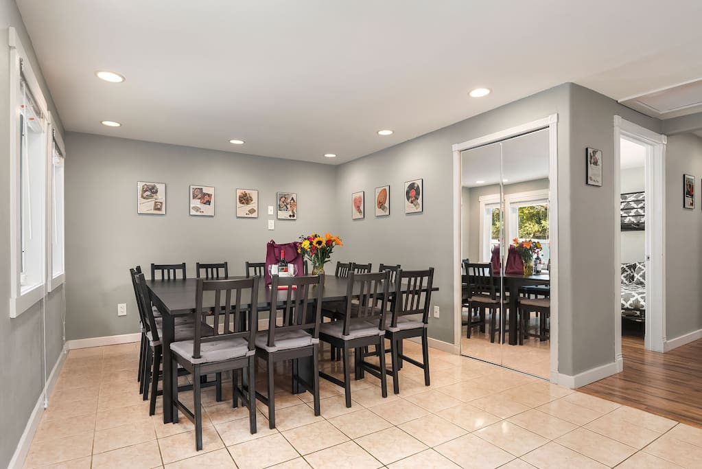 The dining table is the centerpiece of this home, with a table set for 14 and additional folding chairs available