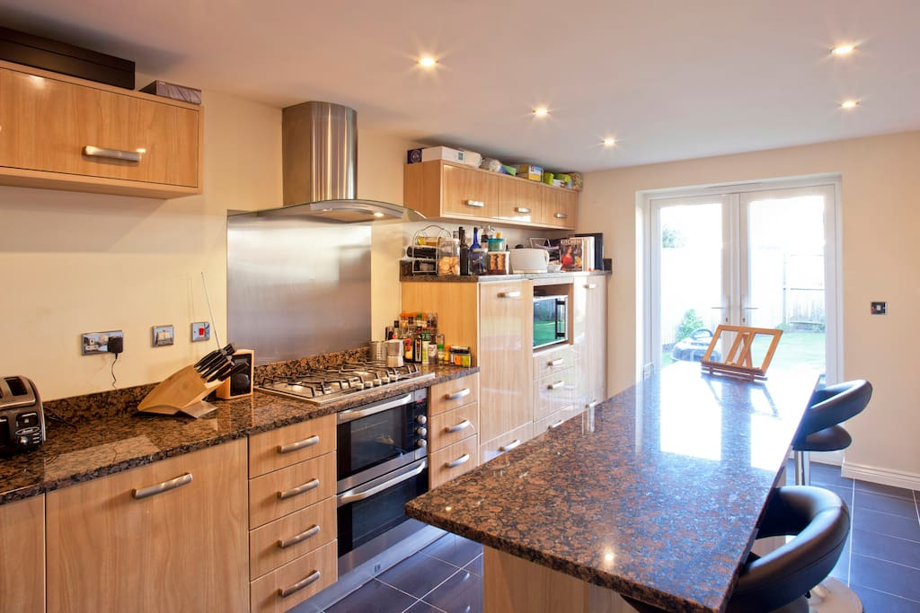 Make yourself at home in the fully fitted modern kitchen