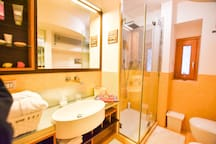 The bathroom with mirror and shower