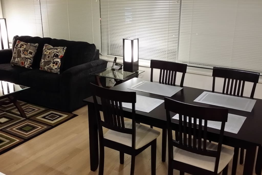 wood floor, large formal dinning table with four chairs