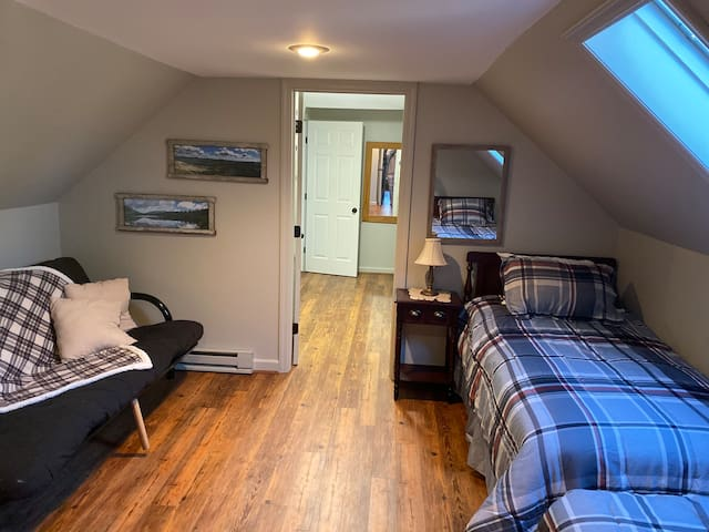 This bedroom upstairs has 2 twin size beds and a futon that can be used as a double bed.