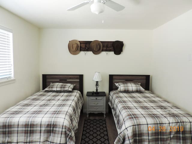 Cowboy Room with Grandpa's hats- memory foam beds