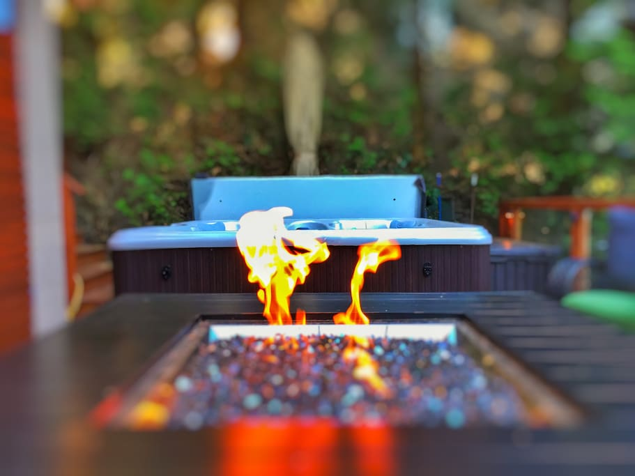Get cozy around the fire after a soak in the hot tub.