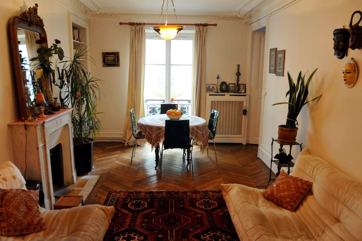 The livingroom of the apartment with marble fireplace.