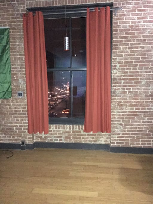 Brick wall with illuminated curtains for elegance!