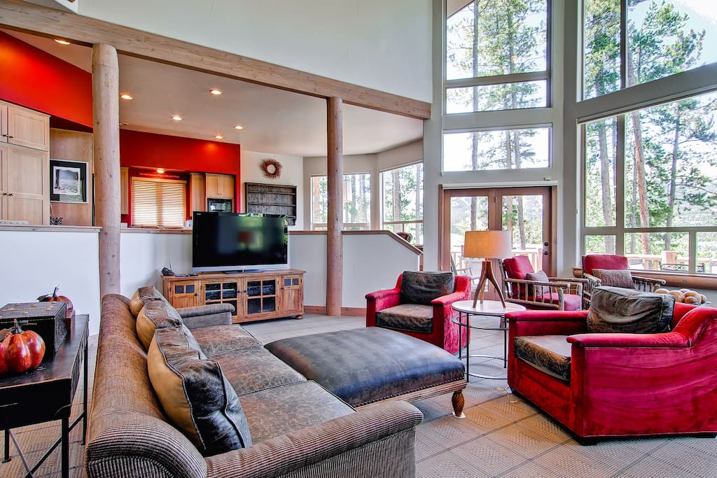 The wall of windows brings nature into your living room. Head outside to the deck and enjoy the 8 person hot tub and gas grill.