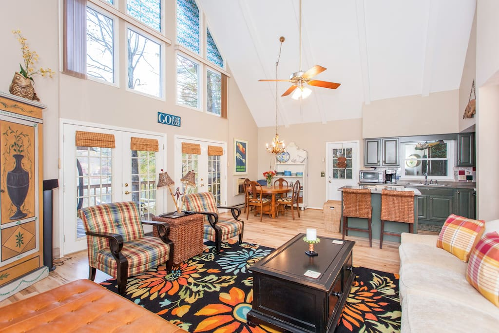 Vaulted ceilings and double-height windows feature in the impressive open living space.