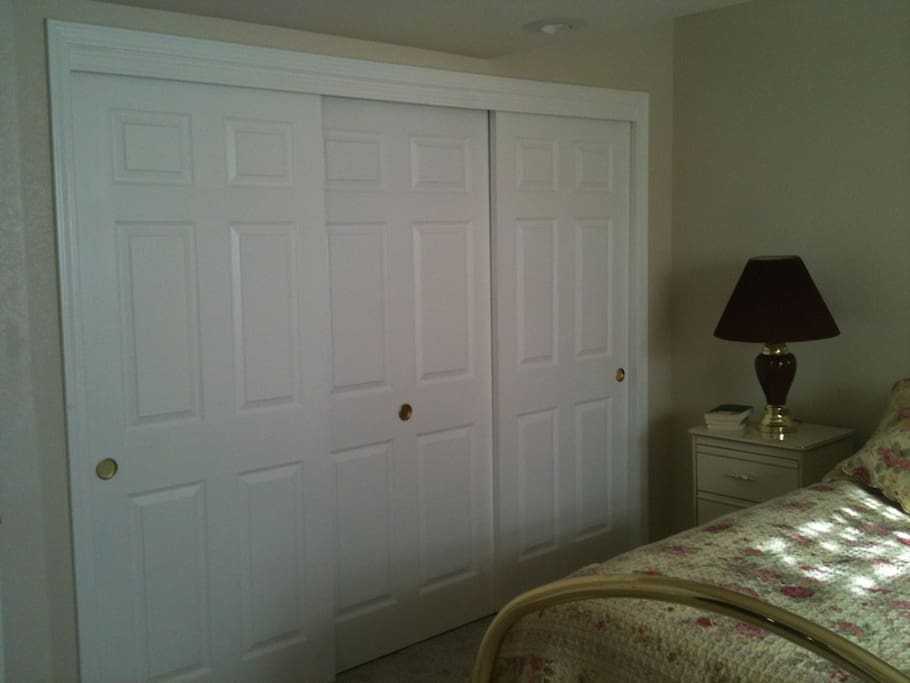 Wall-to-wall bedroom closet.  Lots of space for all your clothes!