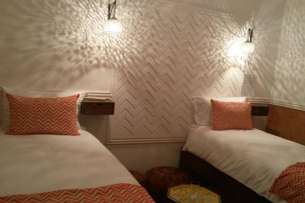 Twin beds with oriental lights