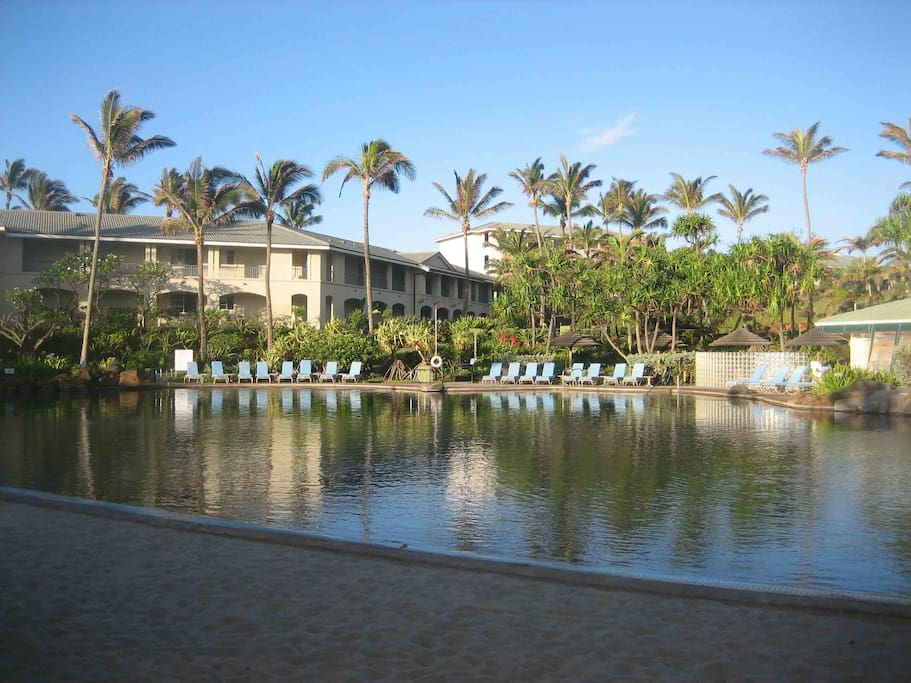 The relaxing pool features a walk in beach on one side and a jacuzzi and cafe.
