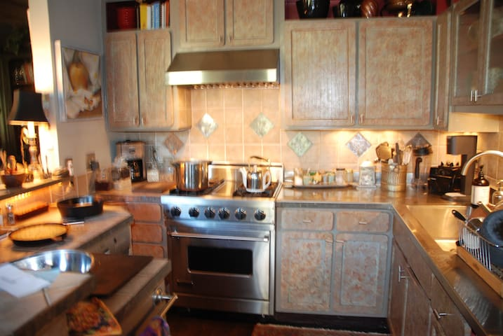 gourmet kitchen and breakfast bar...open to the living areas..
