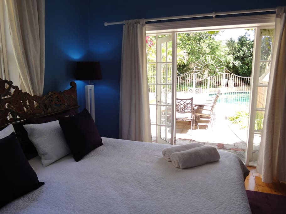The View from the bed over looking the Pool and Courtyard throught the set of French Doors.