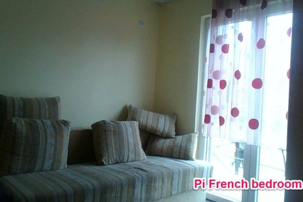 Double Bedroom with Couch and french windows to Balcony