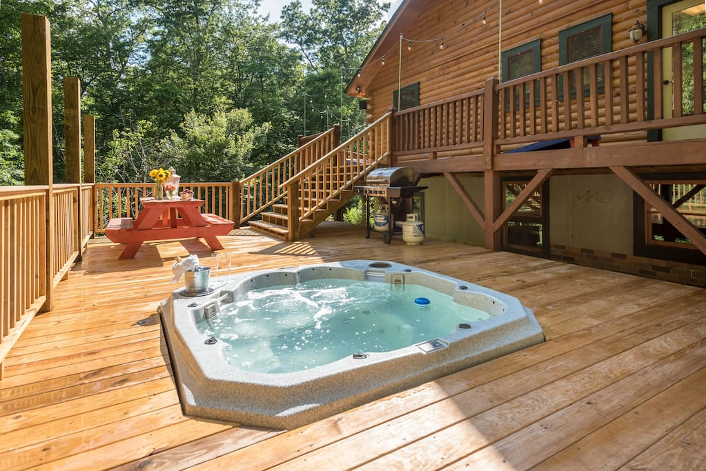 8-person hot tub, propane grill, and outdoor seating. Cornhole set on deck above!