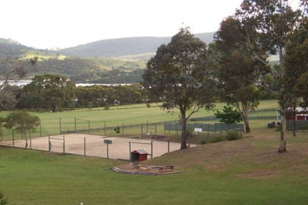 Tennis court with complimentary racquets and balls