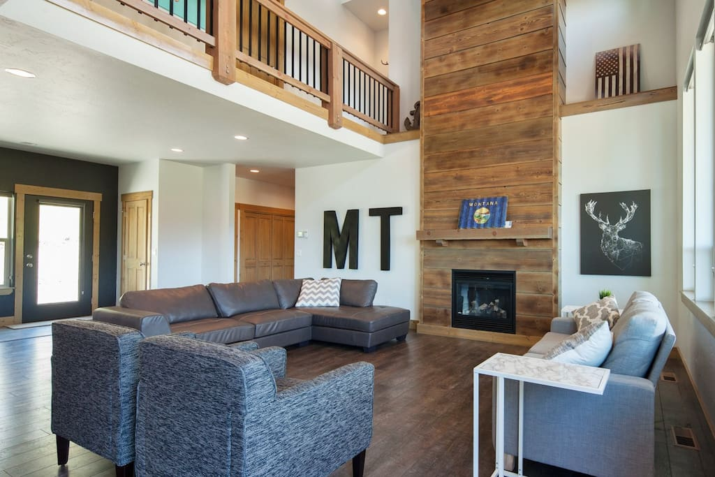 Open concept living room with grand fire place