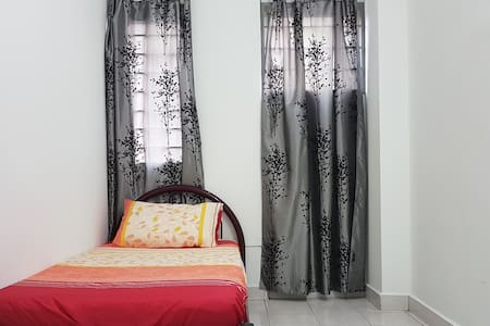 Medium Room 203 with aircon single bed