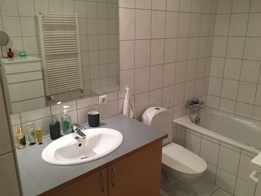 Bathroom with a separate bathtub and shower