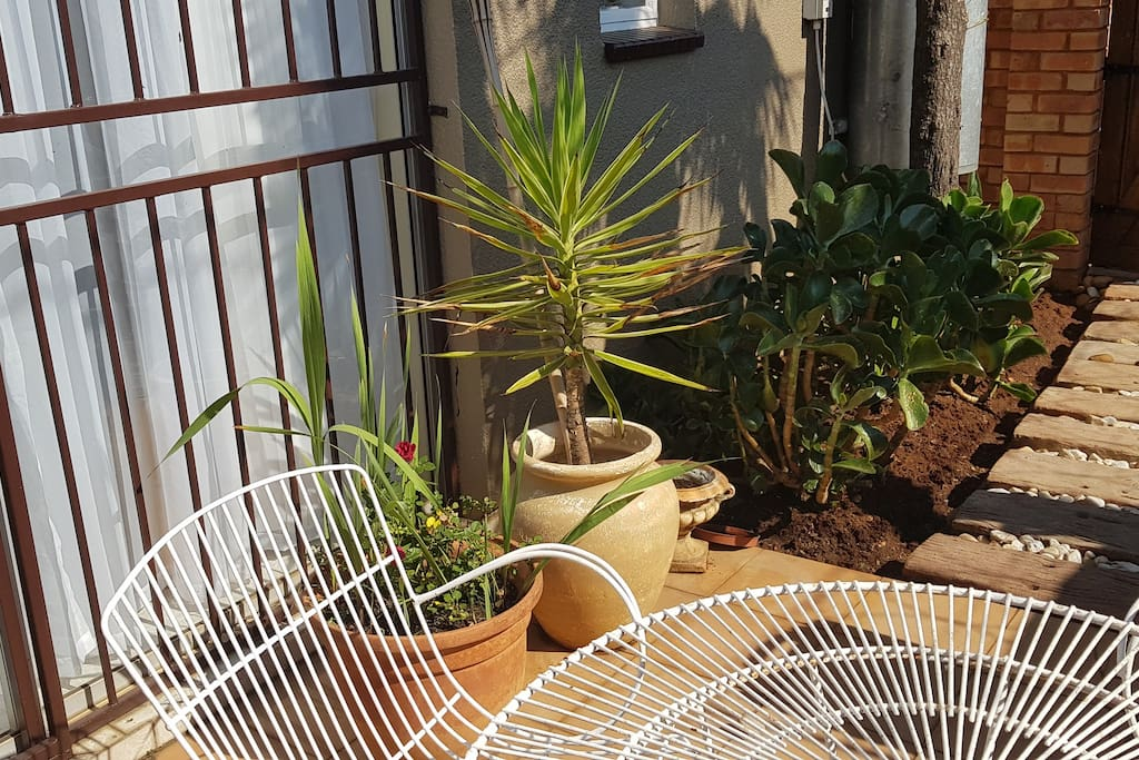 Bask in the Sunshine in your own private garden with gas and normal Braai.